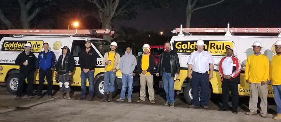 Golden Rule team in front of trucks